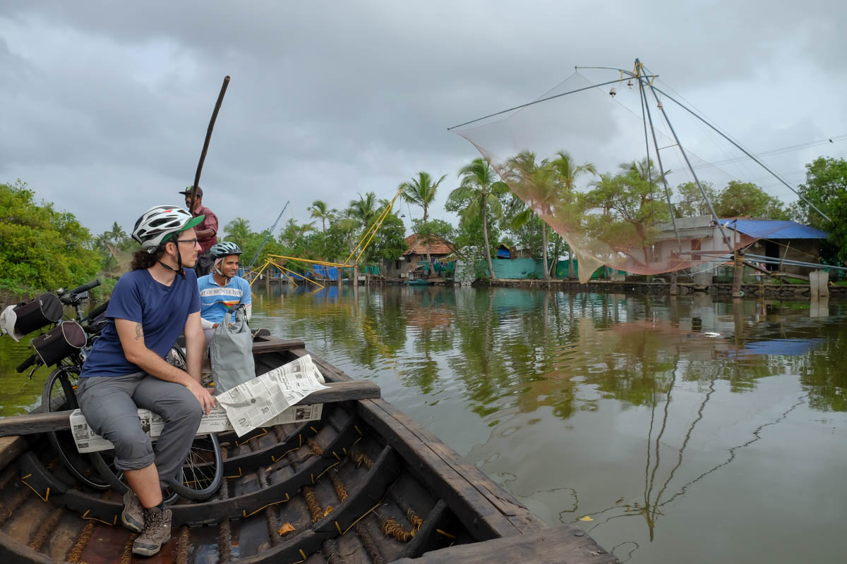 Riding in a traditional boat after a Kochi backwaters bicycle tour