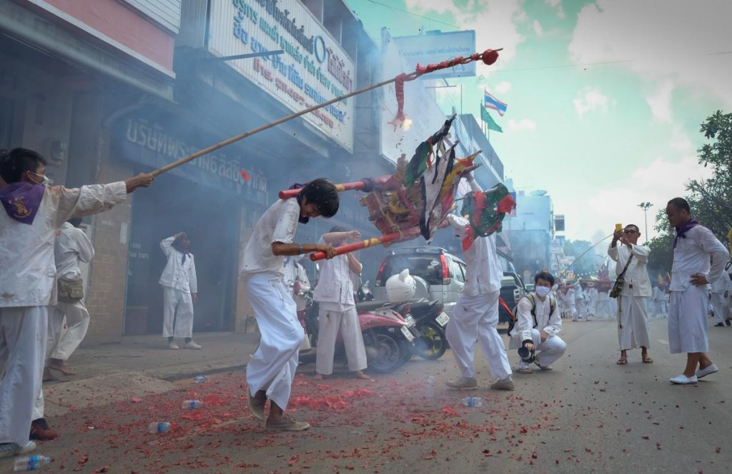 Trang Vegetarian Festival, devotees with fireworks on the street