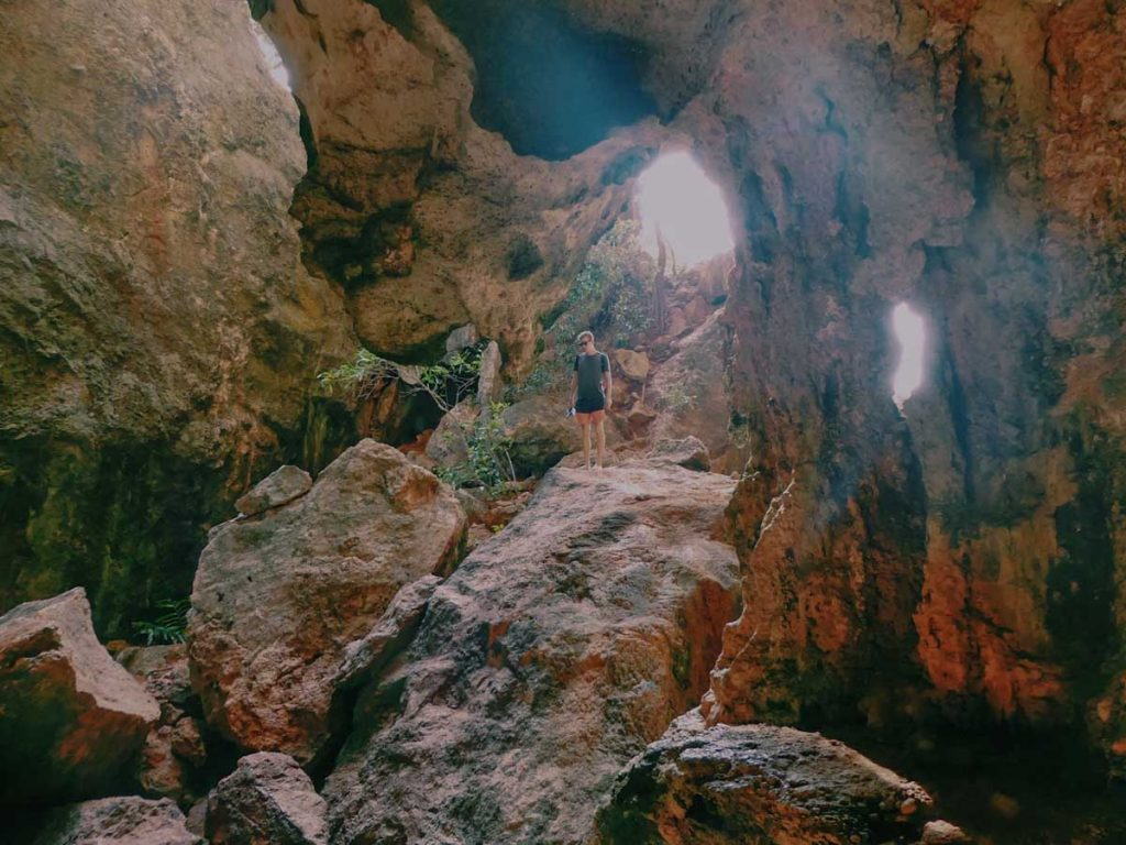Photographing Thailand Krabi caves man standing on top of rock